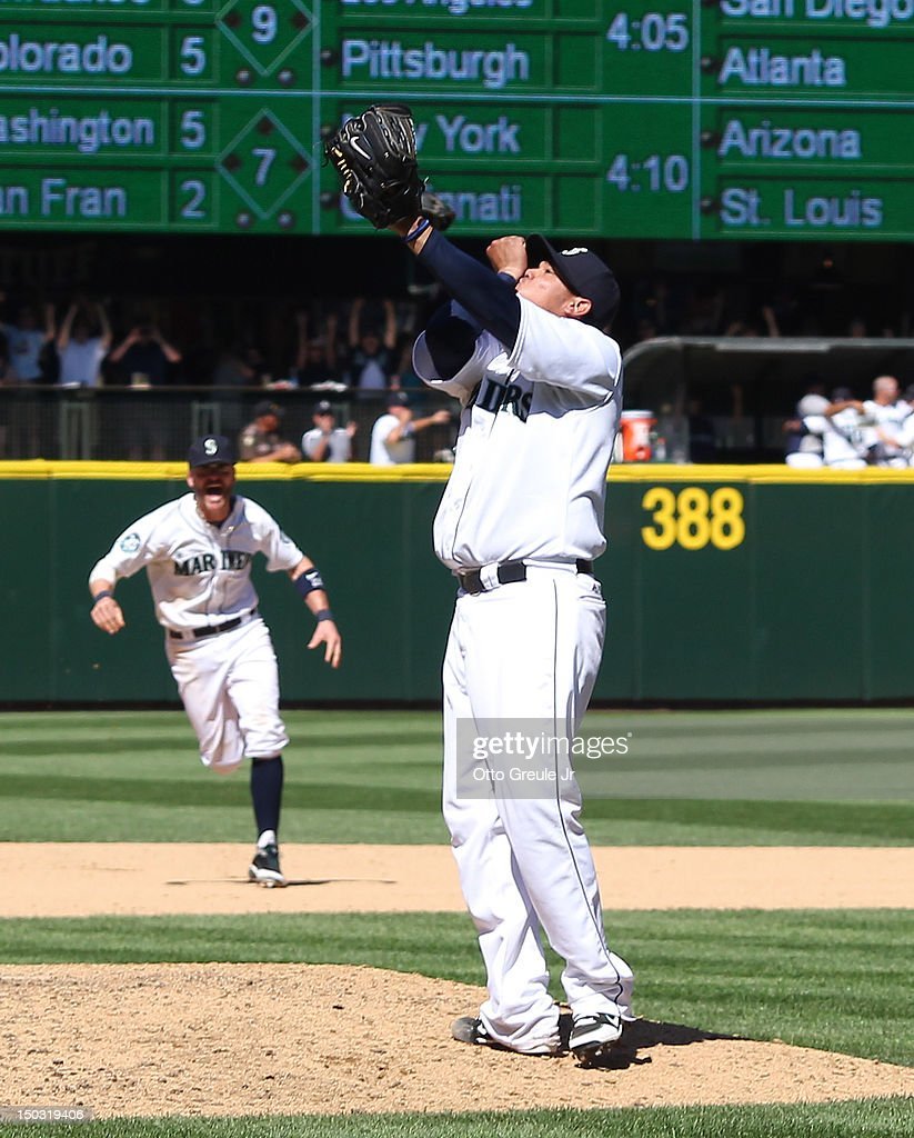 Starting pitcher <a gi-track='captionPersonalityLinkClicked' href=/galleries/search?phrase=Felix+Hernandez&family=editorial&specificpeople=550749 ng-click='$event.stopPropagation()'>Felix Hernandez</a> #34 of the Seattle Mariners celebrates after throwing a perfect game against the Tampa Bay Rays at Safeco Field on August 15, 2012 in Seattle, Washington.