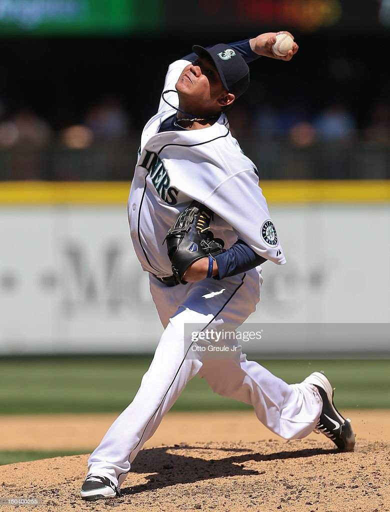 Starting pitcher <a gi-track='captionPersonalityLinkClicked' href=/galleries/search?phrase=Felix+Hernandez&family=editorial&specificpeople=550749 ng-click='$event.stopPropagation()'>Felix Hernandez</a> #34 of the Seattle Mariners pitches in a 1-0 defeat of the Tampa Bay Rays at Safeco Field on August 15, 2012 in Seattle, Washington. Hernandez threw the 23rd perfect game in Major League Baseball history.