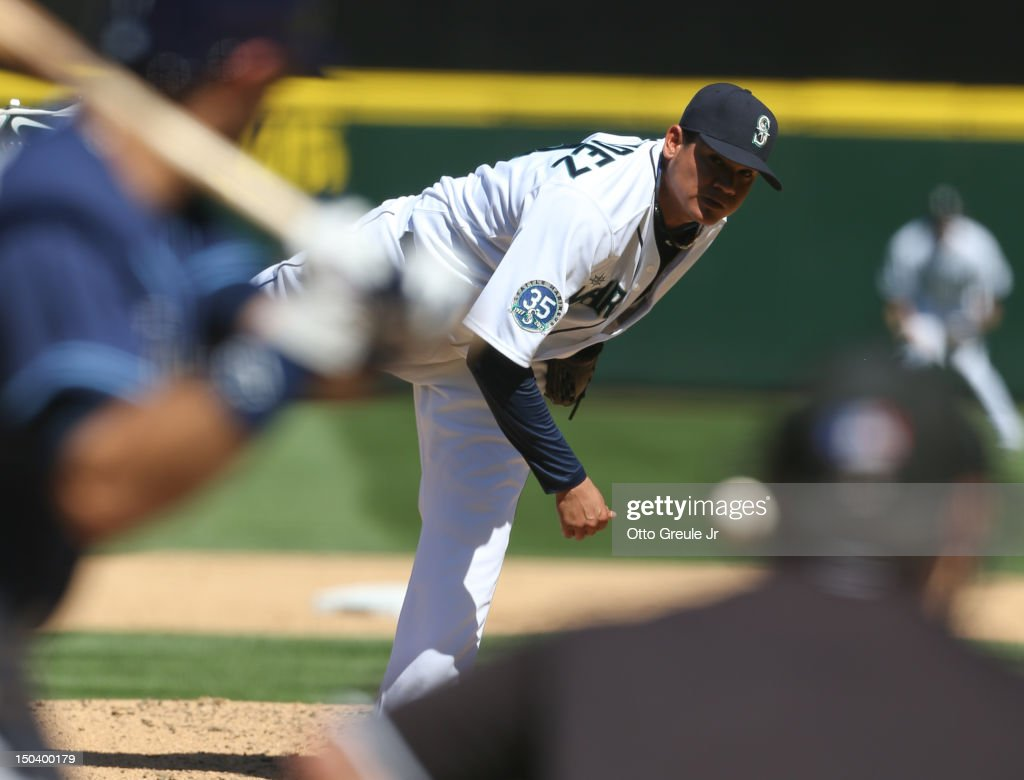 Starting pitcher <a gi-track='captionPersonalityLinkClicked' href=/galleries/search?phrase=Felix+Hernandez&family=editorial&specificpeople=550749 ng-click='$event.stopPropagation()'>Felix Hernandez</a> #34 of the Seattle Mariners pitches in the sixth inning of a 1-0 defeat of the Tampa Bay Rays at Safeco Field on August 15, 2012 in Seattle, Washington. Hernandez threw the 23rd perfect game in Major League Baseball history.
