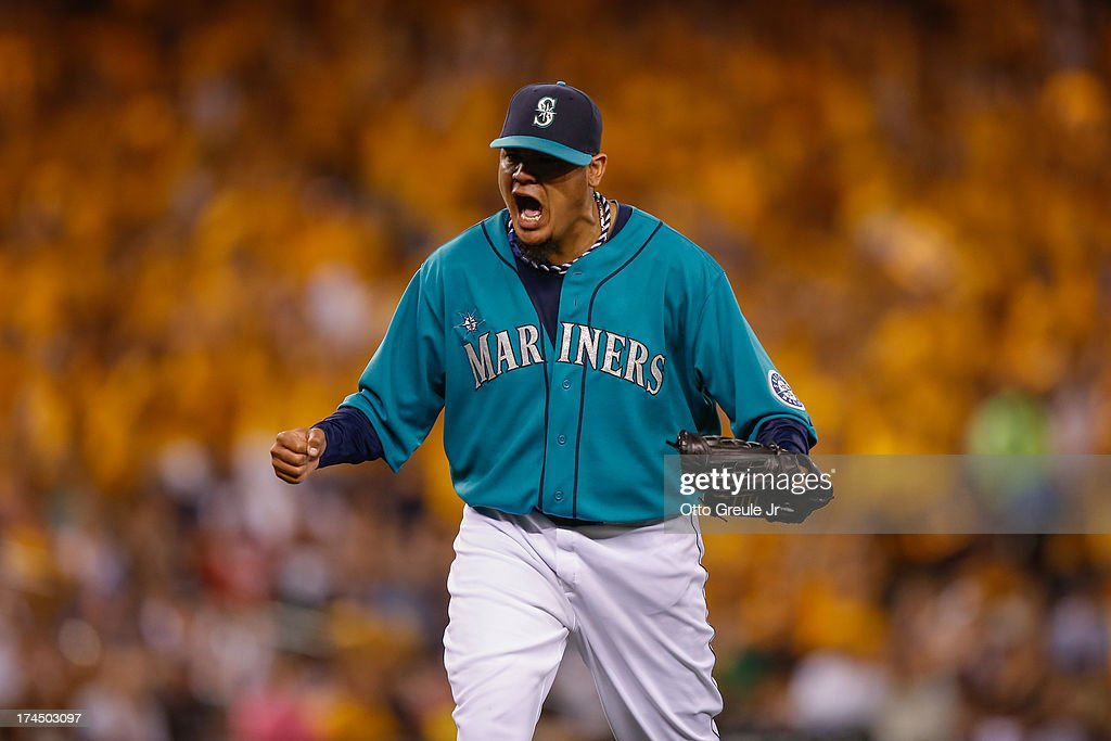 Starting pitcher <a gi-track='captionPersonalityLinkClicked' href=/galleries/search?phrase=Felix+Hernandez&family=editorial&specificpeople=550749 ng-click='$event.stopPropagation()'>Felix Hernandez</a> #34 of the Seattle Mariners reacts after Chris Colabello (not pictured) of the Minnesota Twins hit into a double play to end the eighth inning at Safeco Field on July 26, 2013 in Seattle, Washington.