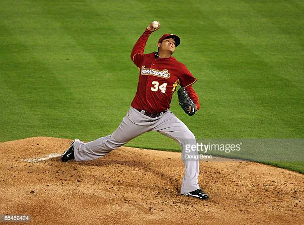 Starting pitcher Felix Hernandez of Venezuela pitches against Puerto Rico during day 3 of round 2 of the World Baseball Classic at Dolphin Stadium on...