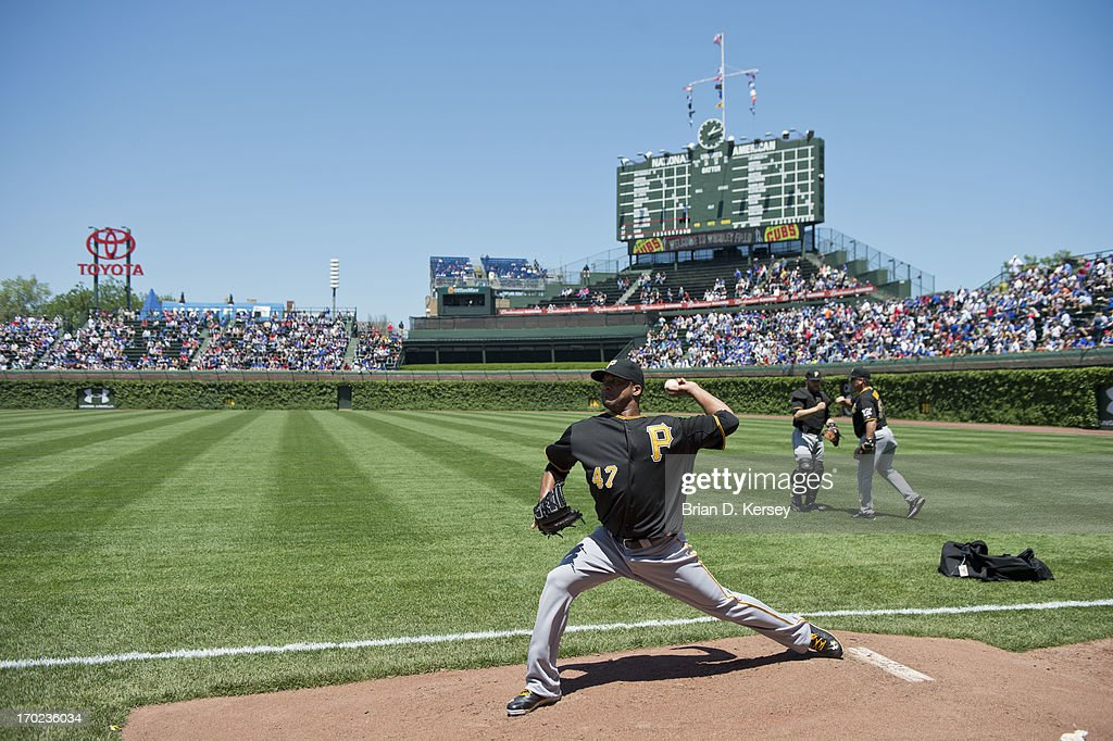 Starting pitcher <a gi-track='captionPersonalityLinkClicked' href=/galleries/search?phrase=Francisco+Liriano&family=editorial&specificpeople=580400 ng-click='$event.stopPropagation()'>Francisco Liriano</a> #47 of the Pittsburgh Pirates warms up in the bullpen before the game against the Chicago Cubs at Wrigley Field on June 7, 2013 in Chicago, Illinois. The Pirates defeated the Cubs 2-0.