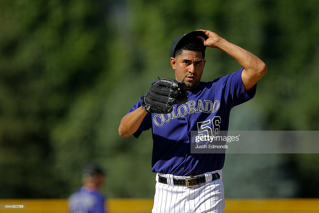 Starting pitcher <a gi-track='captionPersonalityLinkClicked' href=/galleries/search?phrase=Franklin+Morales&family=editorial&specificpeople=4175198 ng-click='$event.stopPropagation()'>Franklin Morales</a> #56 of the Colorado Rockies reacts after giving up a three-run home run to Hunter Pence (not pictured) of the San Francisco Giants during the first inning at Coors Field on September 1, 2014 in Denver, Colorado.