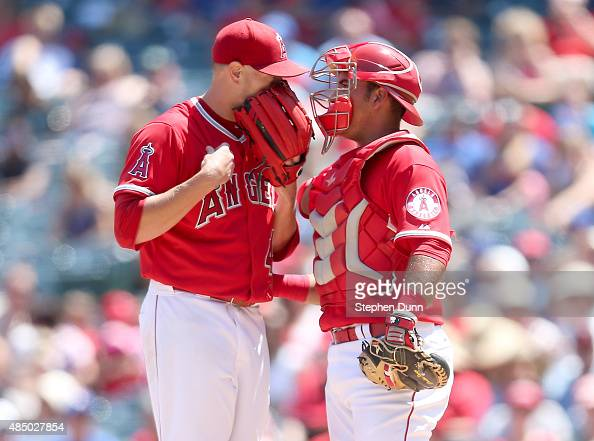 Starting pitcher Garrett Richards and catcher Carlos Perez of the Los Angeles Angels of Anaheim confer in the game aganst the Toronto Blue Jays at...