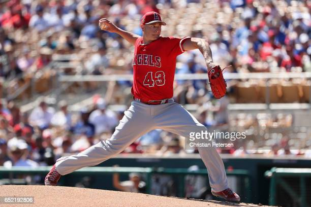 Starting pitcher Garrett Richards of the Los Angeles Angels pitches against the Los Angeles Dodgers during the first inning of the spring training...