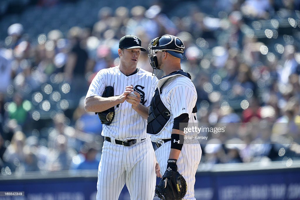 Starting pitcher <a gi-track='captionPersonalityLinkClicked' href=/galleries/search?phrase=Gavin+Floyd&family=editorial&specificpeople=224627 ng-click='$event.stopPropagation()'>Gavin Floyd</a> #34 of the Chicago White Sox (L) and catcher <a gi-track='captionPersonalityLinkClicked' href=/galleries/search?phrase=Tyler+Flowers&family=editorial&specificpeople=4217244 ng-click='$event.stopPropagation()'>Tyler Flowers</a> #21 talk during the third inning against the Kansas City Royals on April 4, 2012 at U.S. Cellular Field in Chicago, Illinois. The Royals defeated the White Sox 3-1.