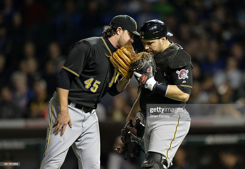 Starting pitcher <a gi-track='captionPersonalityLinkClicked' href=/galleries/search?phrase=Gerrit+Cole&family=editorial&specificpeople=7072350 ng-click='$event.stopPropagation()'>Gerrit Cole</a> #45 of the Pittsburgh Pirates (L) talks with catcher <a gi-track='captionPersonalityLinkClicked' href=/galleries/search?phrase=Russell+Martin+-+Baseball+Player&family=editorial&specificpeople=13764024 ng-click='$event.stopPropagation()'>Russell Martin</a> #55 during the sixth inning against the Chicago Cubs at Wrigley Field on September 24, 2013 in Chicago, Illinois.