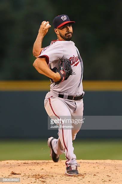 Starting pitcher Gio Gonzalez of the Washington Nationals delivers to home plate during the first inning against the Colorado Rockies at Coors Field...