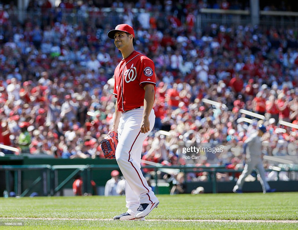 Starting pitcher <a gi-track='captionPersonalityLinkClicked' href=/galleries/search?phrase=Gio+Gonzalez&family=editorial&specificpeople=759378 ng-click='$event.stopPropagation()'>Gio Gonzalez</a> #47 of the Washington Nationals walks to the dugout after the end of the sixth inning against the Chicago Cubs at Nationals Park on May 12, 2013 in Washington, DC.