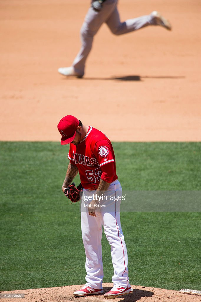 Starting pitcher <a gi-track='captionPersonalityLinkClicked' href=/galleries/search?phrase=Hector+Santiago&family=editorial&specificpeople=3329626 ng-click='$event.stopPropagation()'>Hector Santiago</a> #53 of the Los Angeles Angels of Anaheim reacts as Marcus Semien #10 of the Oakland Athletics runs the bases after hitting a solo home run during the fourth inning of the game at Angel Stadium of Anaheim on June 26, 2016 in Anaheim, California.