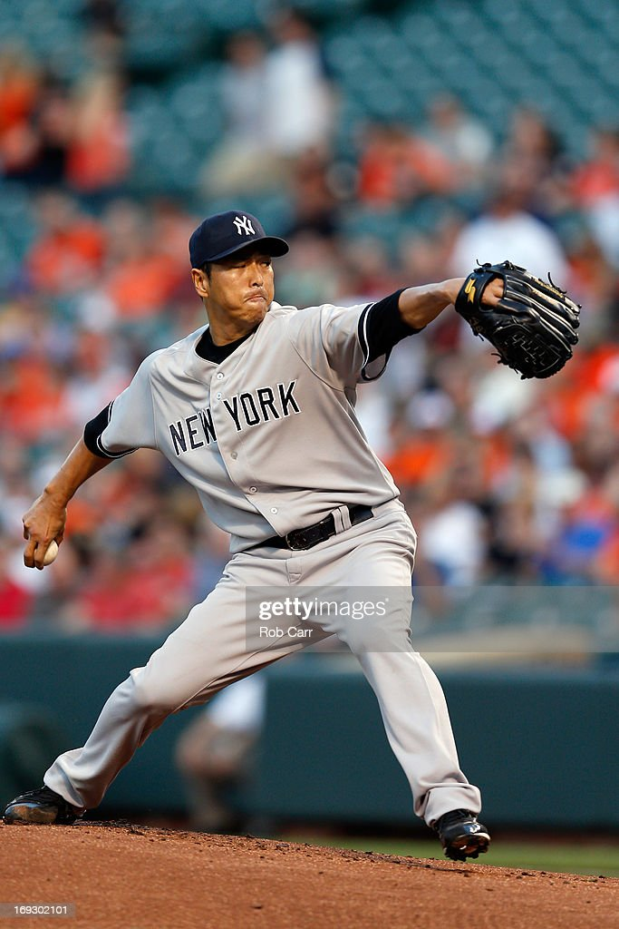 Starting pitcher <a gi-track='captionPersonalityLinkClicked' href=/galleries/search?phrase=Hiroki+Kuroda&family=editorial&specificpeople=5498664 ng-click='$event.stopPropagation()'>Hiroki Kuroda</a> #18 of the New York Yankees throws to a Baltimore Orioles batter during the first inning at Oriole Park at Camden Yards on May 22, 2013 in Baltimore, Maryland.