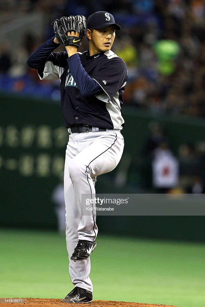 Starting Pitcher Hisashi Iwakuma #18 of Seattle Mariners pitches during in the bottom half of the second inning the pre season game between Yomiuri Giants and Seattle Mariners at Tokyo Dome on March 26, 2012 in Tokyo, Japan.