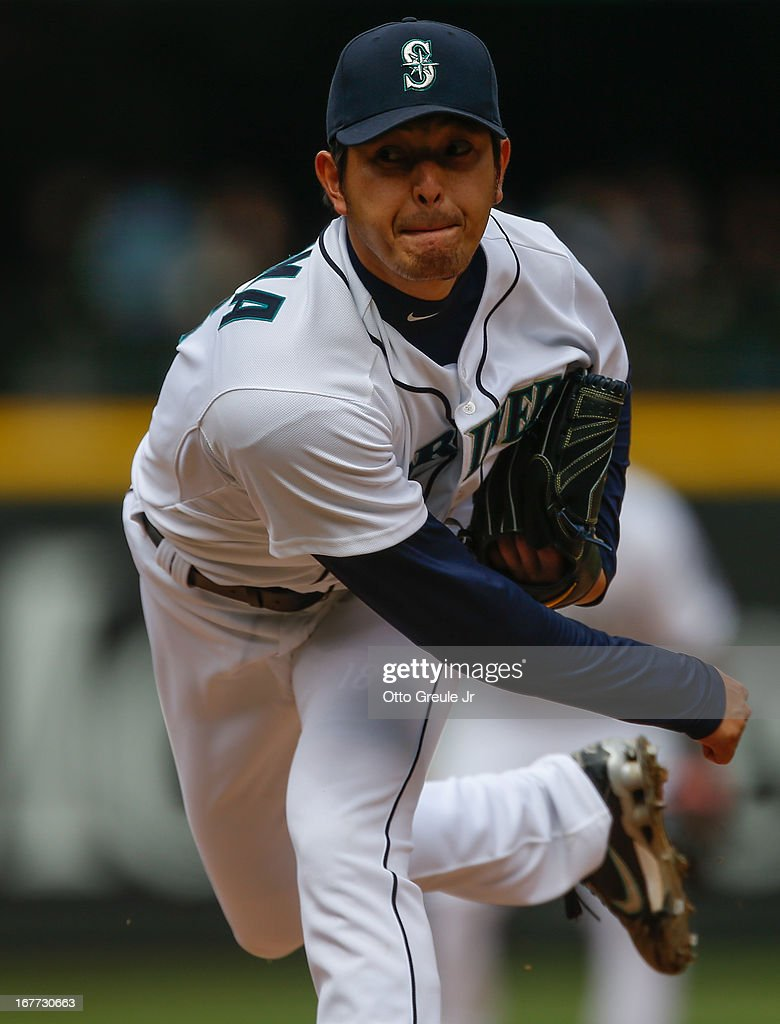Starting pitcher <a gi-track='captionPersonalityLinkClicked' href=/galleries/search?phrase=Hisashi+Iwakuma&family=editorial&specificpeople=5723798 ng-click='$event.stopPropagation()'>Hisashi Iwakuma</a> #18 of the Seattle Mariners follows through on a pitch against the Los Angeles Angels of Anaheim at Safeco Field on April 28, 2013 in Seattle, Washington. The Mariners defeated the Angels 2-1.