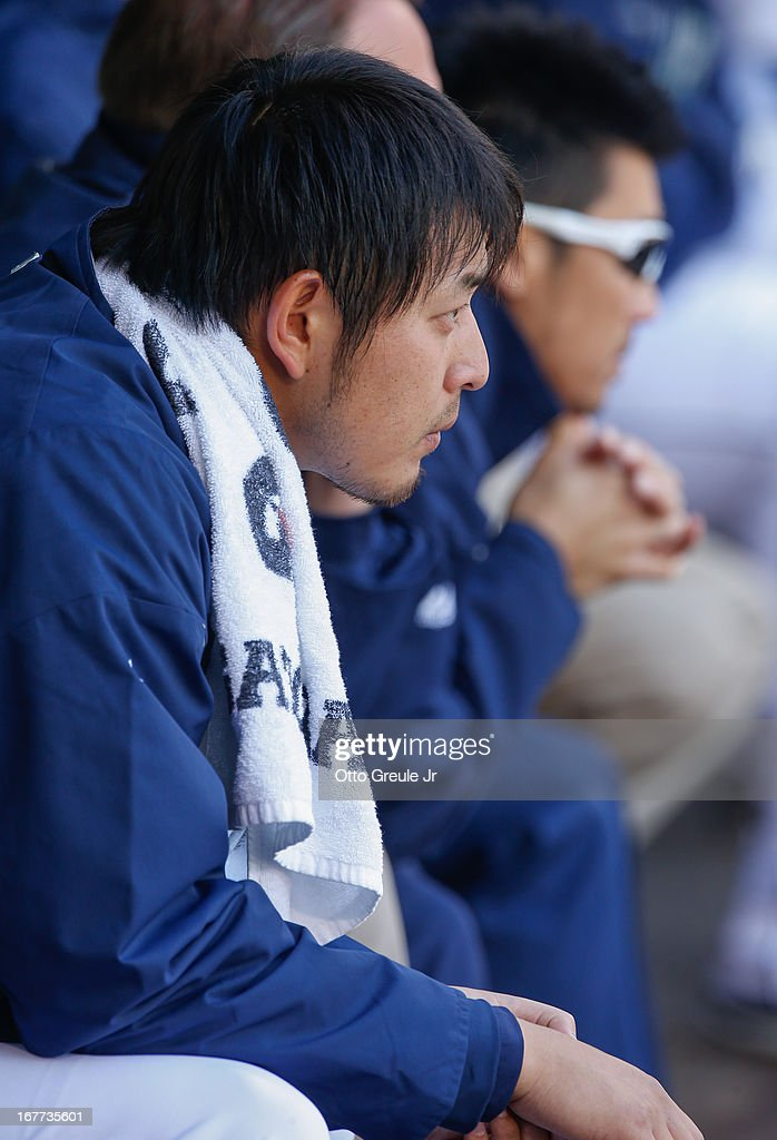 Starting pitcher Hisashi Iwakuma #18 of the Seattle Mariners looks on from the dugout during the game against the Los Angeles Angels of Anaheim at Safeco Field on April 28, 2013 in Seattle, Washington.