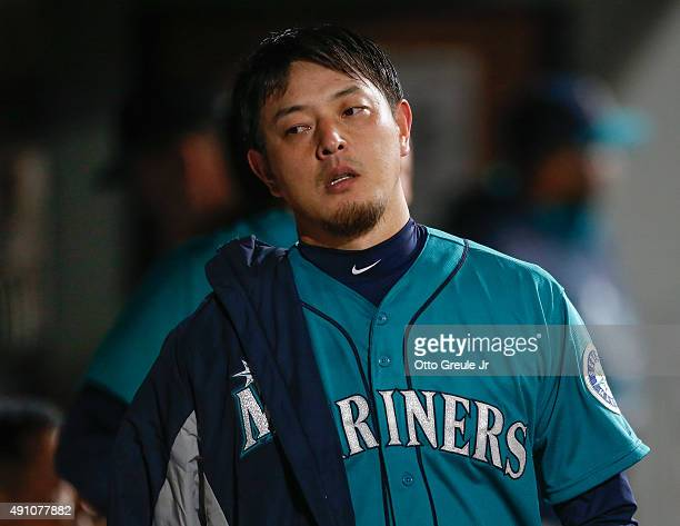 Starting pitcher Hisashi Iwakuma of the Seattle Mariners looks on from the dugout in the seventh inning against the Oakland Athletics at Safeco Field...