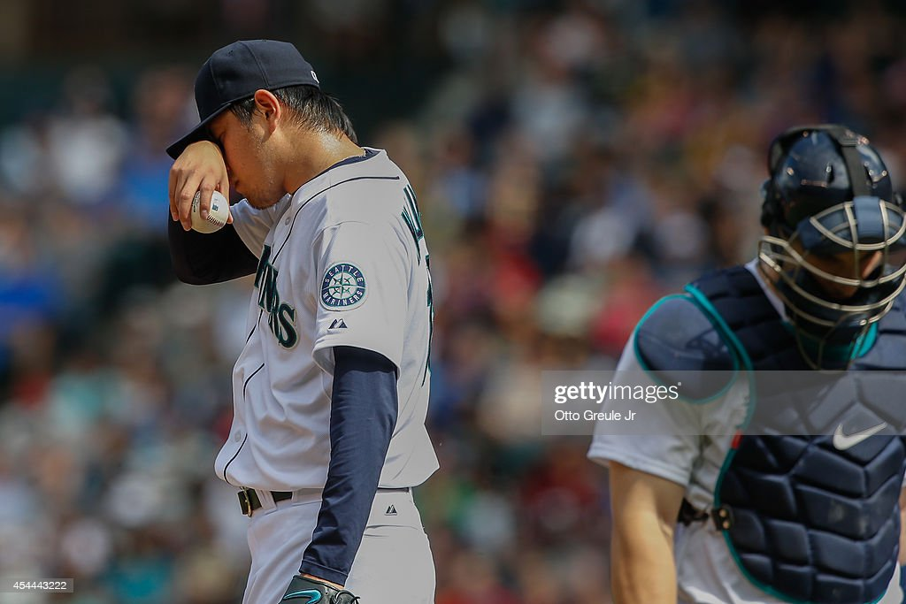 Starting pitcher <a gi-track='captionPersonalityLinkClicked' href=/galleries/search?phrase=Hisashi+Iwakuma&family=editorial&specificpeople=5723798 ng-click='$event.stopPropagation()'>Hisashi Iwakuma</a> #18 of the Seattle Mariners pauses on the mound after giving up a double to Denard Span of the Washington Nationals in the third inning at Safeco Field on August 31, 2014 in Seattle, Washington. The Mariners defeated the Nationals 5-3.