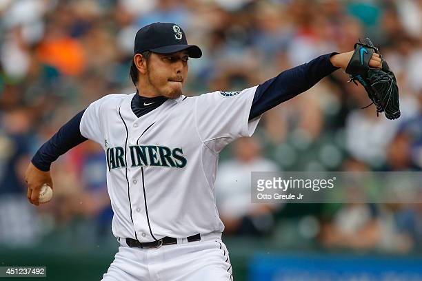 Starting pitcher Hisashi Iwakuma of the Seattle Mariners pitches in the first inning against the Boston Red Sox at Safeco Field on June 25 2014 in...