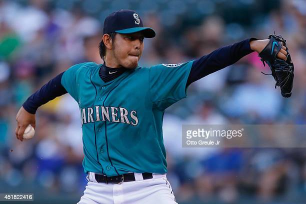 Starting pitcher Hisashi Iwakuma of the Seattle Mariners pitches in the first inning against the Minnesota Twins at Safeco Field on July 7 2014 in...