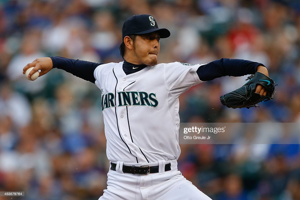 Starting pitcher Hisashi Iwakuma of the Seattle Mariners pitches in the first inning against the Toronto Blue Jays at Safeco Field on August 13 2014...