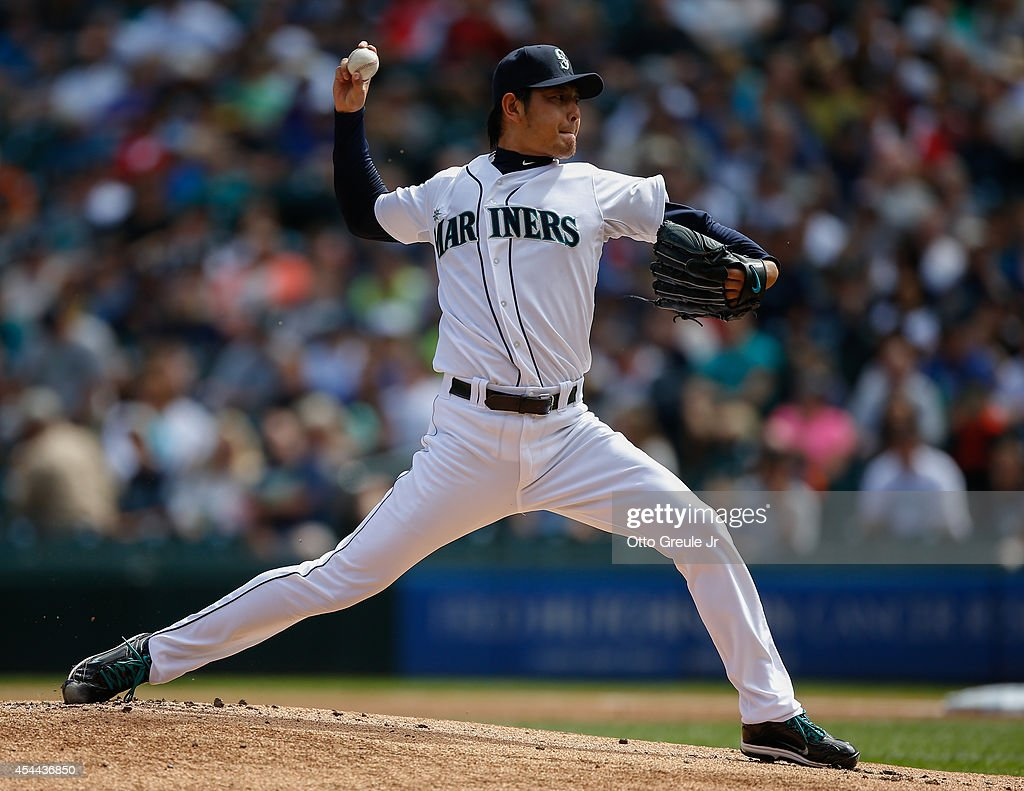 Starting pitcher <a gi-track='captionPersonalityLinkClicked' href=/galleries/search?phrase=Hisashi+Iwakuma&family=editorial&specificpeople=5723798 ng-click='$event.stopPropagation()'>Hisashi Iwakuma</a> #18 of the Seattle Mariners pitches in the first inning against the Washington Nationals at Safeco Field on August 31, 2014 in Seattle, Washington.