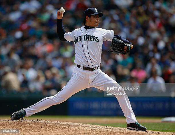 Starting pitcher Hisashi Iwakuma of the Seattle Mariners pitches in the first inning against the Washington Nationals at Safeco Field on August 31...