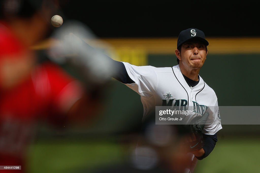 Starting pitcher <a gi-track='captionPersonalityLinkClicked' href=/galleries/search?phrase=Hisashi+Iwakuma&family=editorial&specificpeople=5723798 ng-click='$event.stopPropagation()'>Hisashi Iwakuma</a> #18 of the Seattle Mariners pitches in the fourth inning against the Washington Nationals at Safeco Field on August 31, 2014 in Seattle, Washington.