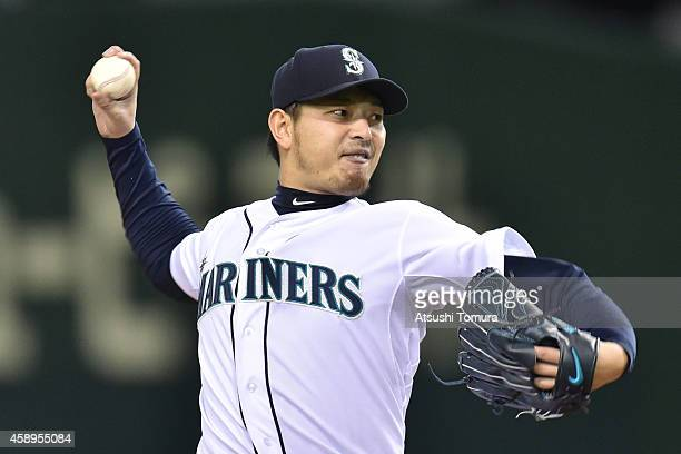 Starting pitcher Hisashi Iwakuma of the Seattle Mariners pitches in the first inning during the game two of Samurai Japan and MLB All Stars at Tokyo...