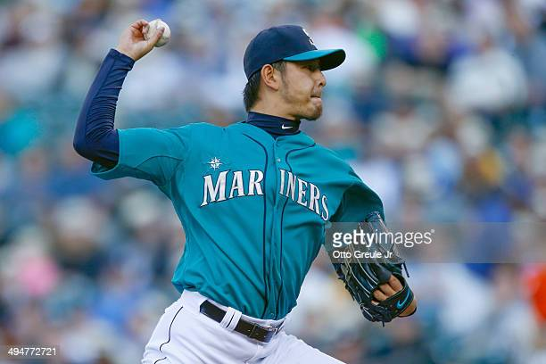 Starting pitcher Hisashi Iwakuma of the Seattle Mariners pitches in the first inning against the Detroit Tigers at Safeco Field on May 30 2014 in...