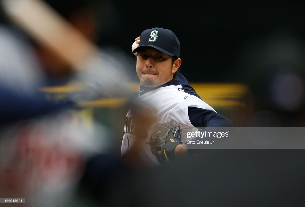 Starting pitcher <a gi-track='captionPersonalityLinkClicked' href=/galleries/search?phrase=Hisashi+Iwakuma&family=editorial&specificpeople=5723798 ng-click='$event.stopPropagation()'>Hisashi Iwakuma</a> #18 of the Seattle Mariners pitches against the Detroit Tigers at Safeco Field on April 18, 2013 in Seattle, Washington.