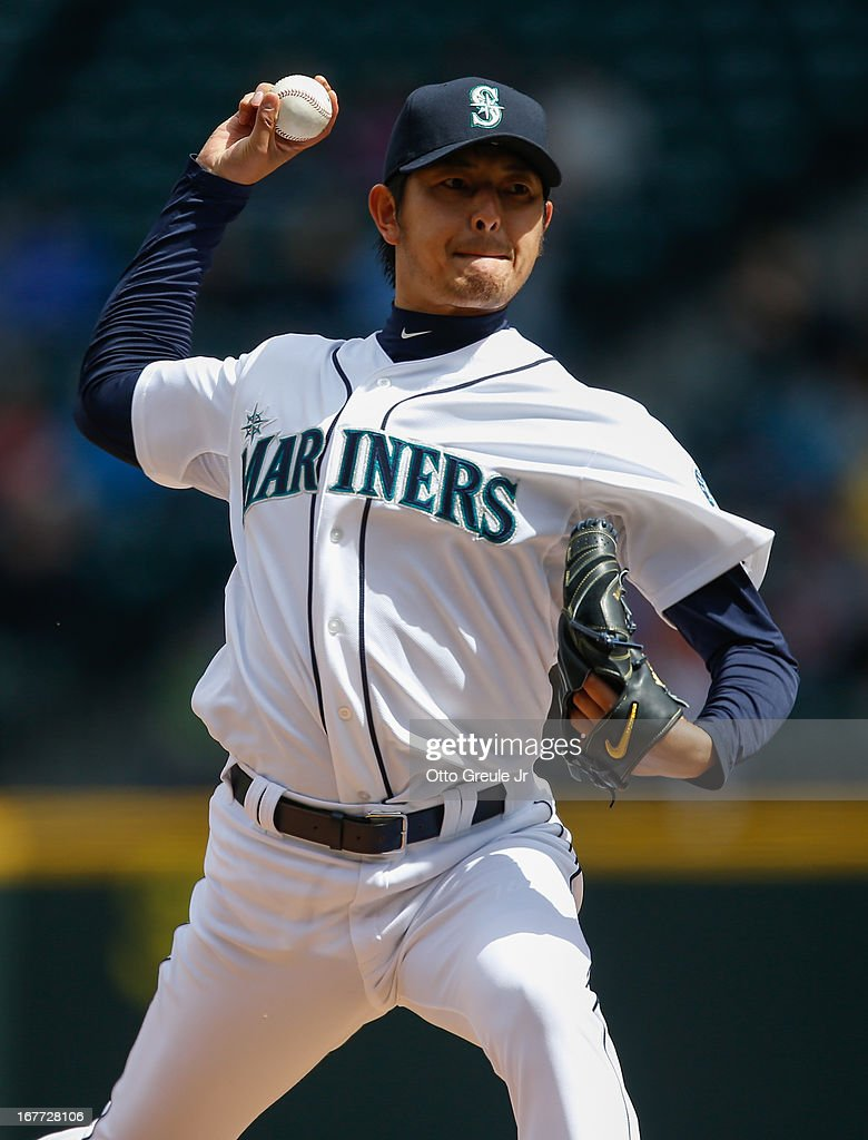 Starting pitcher <a gi-track='captionPersonalityLinkClicked' href=/galleries/search?phrase=Hisashi+Iwakuma&family=editorial&specificpeople=5723798 ng-click='$event.stopPropagation()'>Hisashi Iwakuma</a> #18 of the Seattle Mariners pitches against the Los Angeles Angels of Anaheim at Safeco Field on April 28, 2013 in Seattle, Washington.