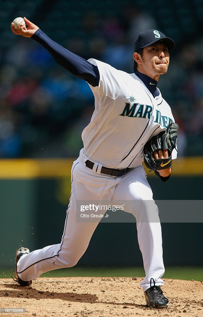 Starting pitcher Hisashi Iwakuma #18 of the Seattle Mariners pitches against the Los Angeles Angels of Anaheim at Safeco Field on April 28, 2013 in Seattle, Washington. The Mariners defeated the Angels 2-1.