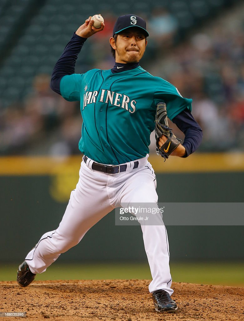Starting pitcher <a gi-track='captionPersonalityLinkClicked' href=/galleries/search?phrase=Hisashi+Iwakuma&family=editorial&specificpeople=5723798 ng-click='$event.stopPropagation()'>Hisashi Iwakuma</a> #18 of the Seattle Mariners pitches against the Oakland Athletics at Safeco Field on May 10, 2013 in Seattle, Washington.
