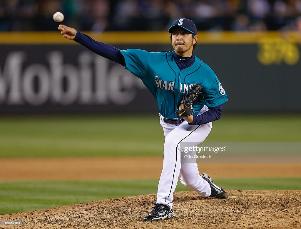 Starting pitcher <a gi-track='captionPersonalityLinkClicked' href=/galleries/search?phrase=Hisashi+Iwakuma&family=editorial&specificpeople=5723798 ng-click='$event.stopPropagation()'>Hisashi Iwakuma</a> #18 of the Seattle Mariners pitches against the Oakland Athletics at Safeco Field on May 10, 2013 in Seattle, Washington. The Mariners defeated the Athletics 6-3.
