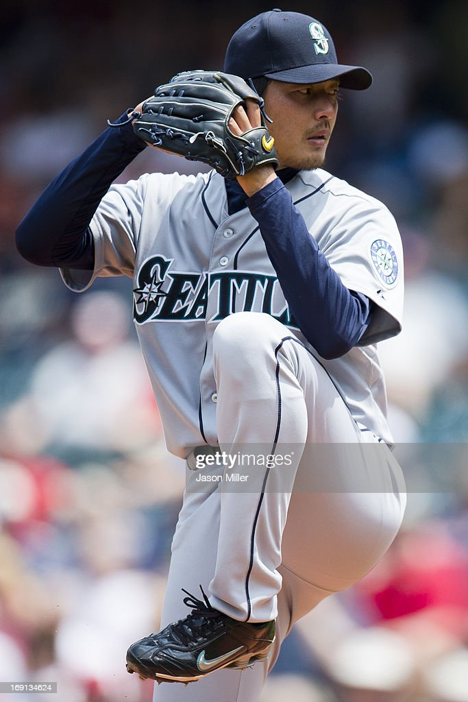 Starting pitcher <a gi-track='captionPersonalityLinkClicked' href=/galleries/search?phrase=Hisashi+Iwakuma&family=editorial&specificpeople=5723798 ng-click='$event.stopPropagation()'>Hisashi Iwakuma</a> #18 of the Seattle Mariners pitches during the third inning against the Cleveland Indians at Progressive Field on May 20, 2013 in Cleveland, Ohio.