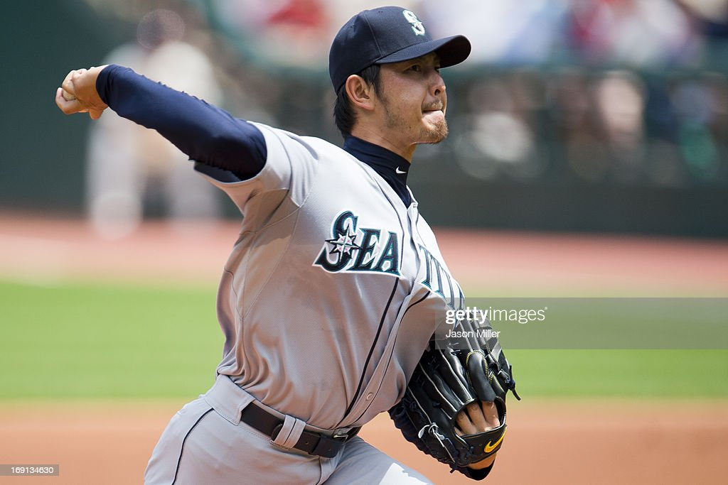 Starting pitcher <a gi-track='captionPersonalityLinkClicked' href=/galleries/search?phrase=Hisashi+Iwakuma&family=editorial&specificpeople=5723798 ng-click='$event.stopPropagation()'>Hisashi Iwakuma</a> #18 of the Seattle Mariners pitches during the first inning against the Cleveland Indians at Progressive Field on May 20, 2013 in Cleveland, Ohio.