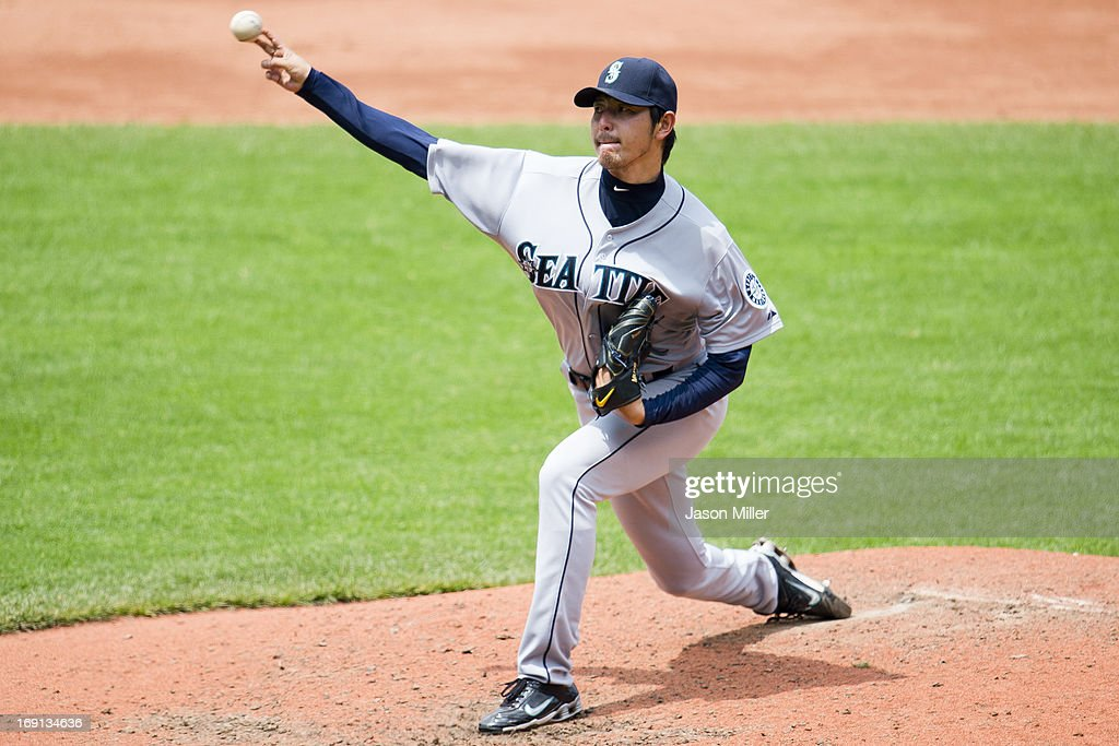 Starting pitcher <a gi-track='captionPersonalityLinkClicked' href=/galleries/search?phrase=Hisashi+Iwakuma&family=editorial&specificpeople=5723798 ng-click='$event.stopPropagation()'>Hisashi Iwakuma</a> #18 of the Seattle Mariners pitches during the fourth inning against the Cleveland Indians at Progressive Field on May 20, 2013 in Cleveland, Ohio.