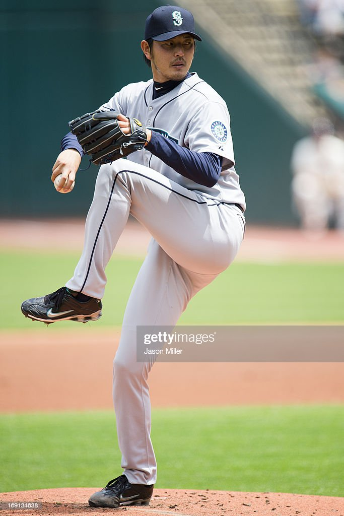 Starting pitcher Hisashi Iwakuma #18 of the Seattle Mariners pitches during the first inning against the Cleveland Indians at Progressive Field on May 20, 2013 in Cleveland, Ohio.