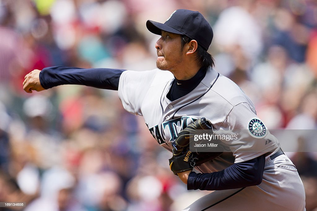Starting pitcher <a gi-track='captionPersonalityLinkClicked' href=/galleries/search?phrase=Hisashi+Iwakuma&family=editorial&specificpeople=5723798 ng-click='$event.stopPropagation()'>Hisashi Iwakuma</a> #18 of the Seattle Mariners pitches during the second inning against the Cleveland Indians at Progressive Field on May 20, 2013 in Cleveland, Ohio.