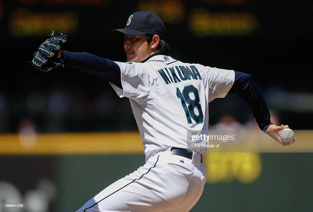 Starting pitcher <a gi-track='captionPersonalityLinkClicked' href=/galleries/search?phrase=Hisashi+Iwakuma&family=editorial&specificpeople=5723798 ng-click='$event.stopPropagation()'>Hisashi Iwakuma</a> #18 of the Seattle Mariners pitches against the Chicago White Sox at Safeco Field on June 5, 2013 in Seattle, Washington. The White Sox defeated the Mariners 7-5 in sixteen innings.