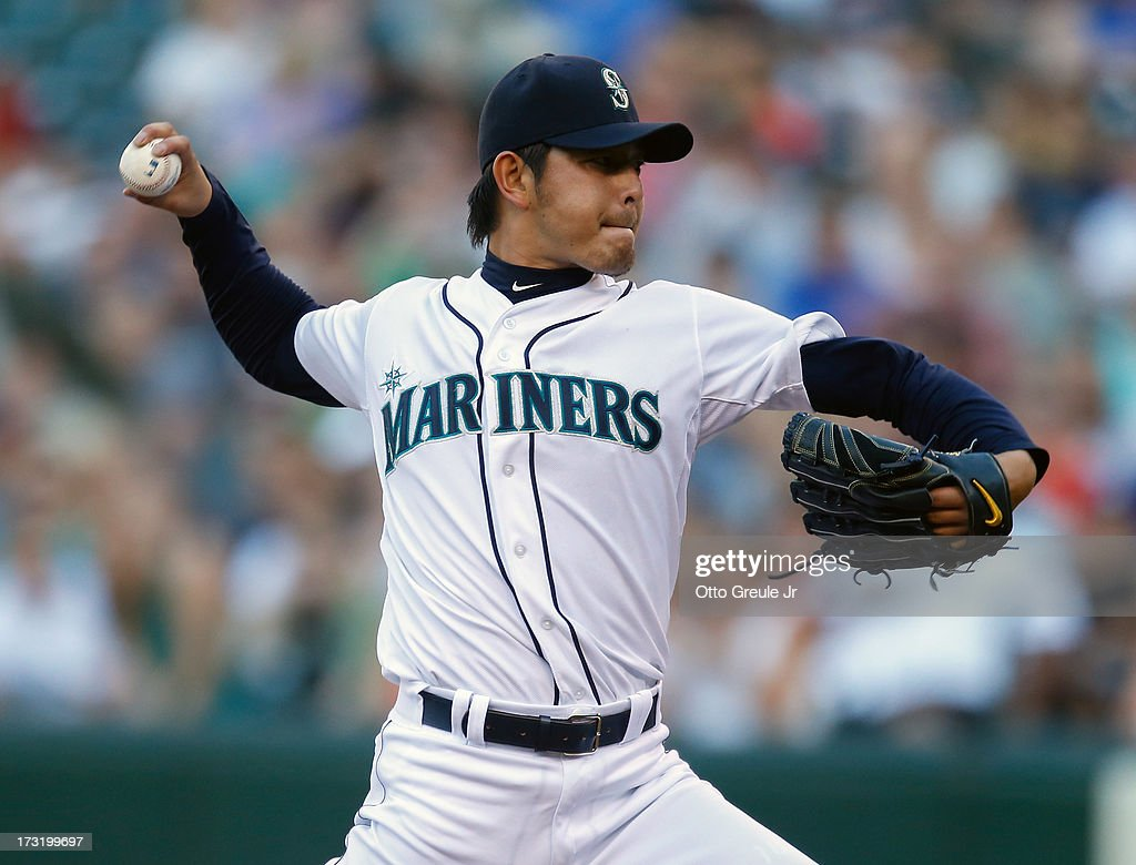 Starting pitcher <a gi-track='captionPersonalityLinkClicked' href=/galleries/search?phrase=Hisashi+Iwakuma&family=editorial&specificpeople=5723798 ng-click='$event.stopPropagation()'>Hisashi Iwakuma</a> #18 of the Seattle Mariners pitches against the Boston Red Sox at Safeco Field on July 9, 2013 in Seattle, Washington.