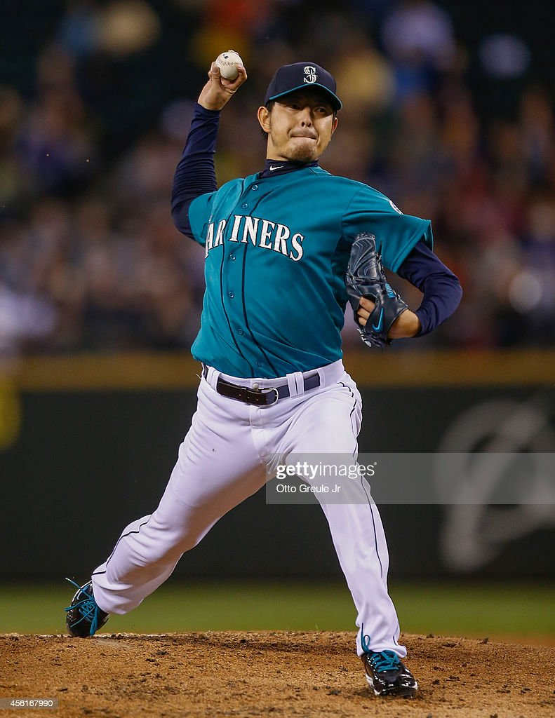 Starting pitcher <a gi-track='captionPersonalityLinkClicked' href=/galleries/search?phrase=Hisashi+Iwakuma&family=editorial&specificpeople=5723798 ng-click='$event.stopPropagation()'>Hisashi Iwakuma</a> #18 of the Seattle Mariners pitches against the Los Angeles Angels of Anaheim in the second inning at Safeco Field on September 26, 2014 in Seattle, Washington.