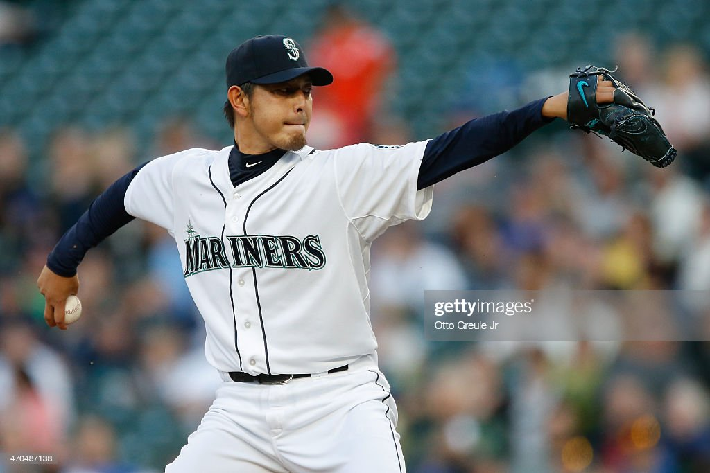 Starting pitcher <a gi-track='captionPersonalityLinkClicked' href=/galleries/search?phrase=Hisashi+Iwakuma&family=editorial&specificpeople=5723798 ng-click='$event.stopPropagation()'>Hisashi Iwakuma</a> #18 of the Seattle Mariners pitches against the Houston Astros in the first inning at Safeco Field on April 20, 2015 in Seattle, Washington.