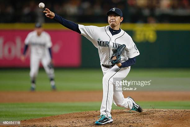 Starting pitcher Hisashi Iwakuma of the Seattle Mariners pitches against the Los Angeles Angels of Anaheim in the third inning at Safeco Field on...