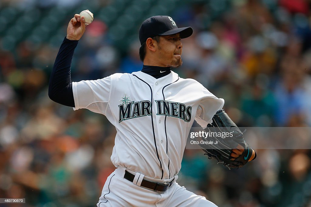 Starting pitcher Hisashi Iwakuma of the Seattle Mariners pitches against the Baltimore Orioles in the first inning at Safeco Field on August 12 2015...