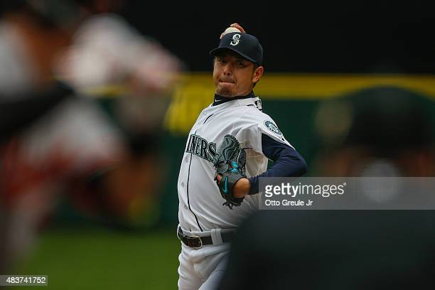 Starting pitcher Hisashi Iwakuma of the Seattle Mariners pitches against the Baltimore Orioles in the third inning at Safeco Field on August 12 2015...