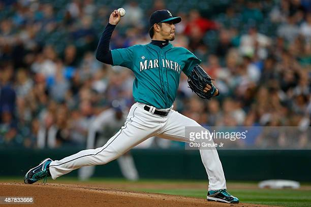 Starting pitcher Hisashi Iwakuma of the Seattle Mariners pitches against the Colorado Rockies in the first inning at Safeco Field on September 11...