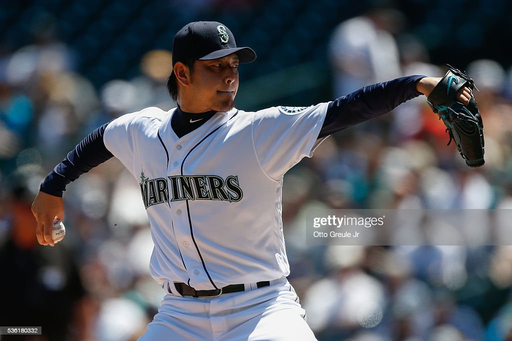 Starting pitcher <a gi-track='captionPersonalityLinkClicked' href=/galleries/search?phrase=Hisashi+Iwakuma&family=editorial&specificpeople=5723798 ng-click='$event.stopPropagation()'>Hisashi Iwakuma</a> #18 of the Seattle Mariners pitches against the San Diego Padres in the first inning at Safeco Field on May 31, 2016 in Seattle, Washington.