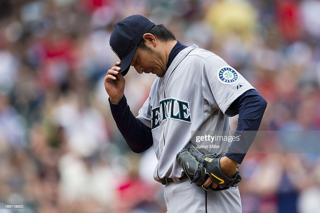 Starting pitcher Hisashi Iwakuma #18 of the Seattle Mariners reacts after giving up two homers for four runs during the second inning against the Cleveland Indians at Progressive Field on May 20, 2013 in Cleveland, Ohio.