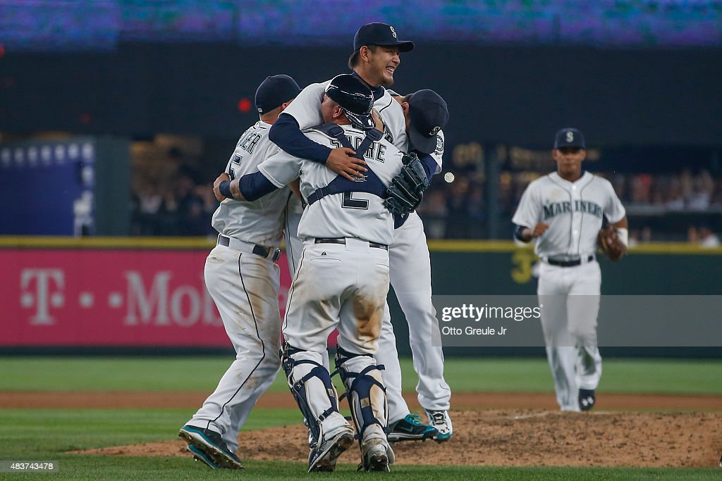 Starting pitcher <a gi-track='captionPersonalityLinkClicked' href=/galleries/search?phrase=Hisashi+Iwakuma&family=editorial&specificpeople=5723798 ng-click='$event.stopPropagation()'>Hisashi Iwakuma</a> #18 of the Seattle Mariners reacts after throwing a no-hitter to defeat the Baltimore Orioles 3-0 at Safeco Field on August 12, 2015 in Seattle, Washington.