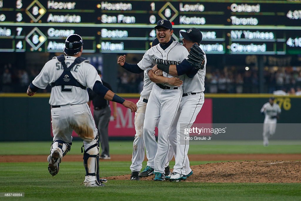 Starting pitcher Hisashi Iwakuma of the Seattle Mariners reacts after throwing a nohitter to defeat the Baltimore Orioles 30 at Safeco Field on...